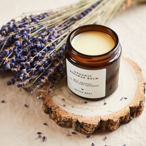 Organic Beeswax Balm Organic Tea Tree and Lavender on wooden board